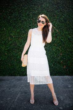 Dallas blogger, Amy Havins, wears a white shoshanna midi dress.