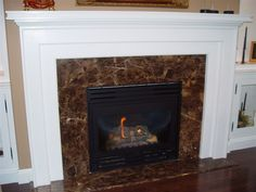 Fireplace facing & hearth in Emperador Brown marble Stone Tile Fireplace, Granite Fireplace, Marble Fireplace Surround, Natural Stone Fireplaces, Rock Fireplaces, Marble Fireplaces, Fireplace Surrounds, Fireplace Design, Stone Tiles