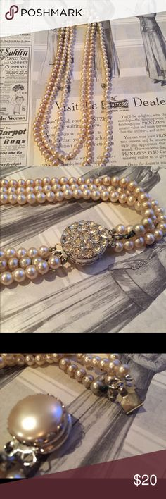 •VTG• Sarah Coventry Three Strand Pearl Necklace This beautiful vintage costume piece is made by Designer Sarah Coventry. It's got three strands of faux pearls attached to a two sided clasp with rhinestones on one side and Pearl on the other. Clasp in good working order. Marked Sarah Cov on the flat side of clasp. Some patina but that doesn't detract From this vintage pretty! All vintage pieces sold are over 20 years old at least so minor imperfections are to be expected. But still wearable…