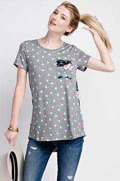 Floral and Polkadot pocket top. Super cute and easy to dress up with Shorts or Jeans..