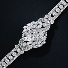 LOVE the movement in this! Mid-Century Platinum and Diamond Bracelet