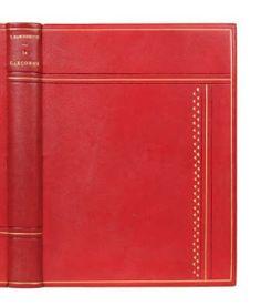 MARGUERITTE V  La garçonne. Francis Guillot Editeur Paris 1936. Edition illustrée par Edouard CHIMOT. L'un des 285 ex sur Rives. Reliure in-8 plein chagrin rouge, plats à décors géométriques, contre plats à encadrement dos lisse couvertures conservées, étui