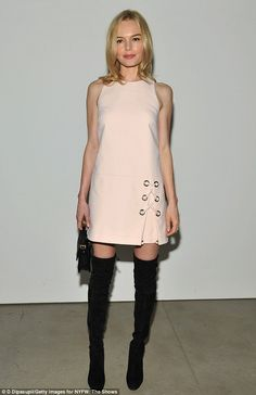 Go-go gorgeous: Kate Bosworth went sixties mod in a pale pink Rebecca Minkoff mini-dress with thigh-high boots at New York Fashion Week on Saturday