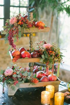 Flowers and fruit on a cake stand.  Event Planning: The Event Company | Floral Design: Studio 7. Photography: Anna Roussos Photography - annaroussos.com