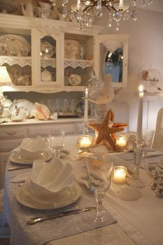 Coastal Tablescape, like the tiered cake plate idea
