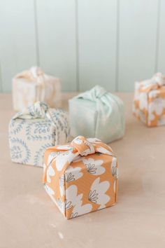 DIY Knotted Fabric Gift Wrap Tutorial from Julep.This tutorial only requires 2 cuts to create this neatly folded and wrapped gift box. This could be a good fabric stash buster and lovely wrapping for gifts given or products sold.