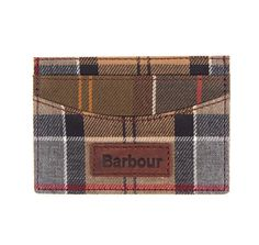 Showcasing a mix of Barbour's house tartans, this sophisticated card holder is constructed with six card slots and a central pocket for notes. Presented in a branded gift box, it's finished at the front with an embossed Barbour logo on a real leather patch.
