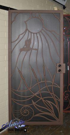 Sun, clouds, duck, cat-o-nine tails, ocean and nautilus wrought iron security screen door