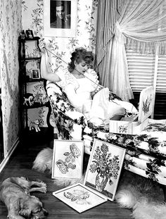 """sparklejamesysparkle: """" Lucille Ball does needlepoint at the Desilu Ranch in Chatsworth California while a portrait of her husband Desi Arnaz looks on, mid-1940s. High-strung and bursting with nervous energy in real life, Lucille rarely rested when..."""