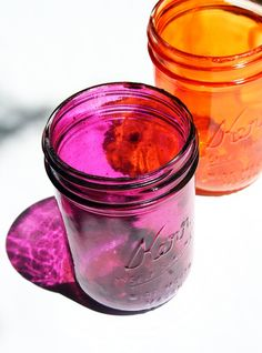 Modge Podge + Food Coloring to make beautiful, colorful mason jars. (Mix Modge Podge and coloring in a bowl then coat the inside of the jar. Make sure color is dark enough for bright color. Place upside down on wax paper 30 min. Then put in oven 170 for 10min upside on wax paper. Then turn right side up for 30 min. Perfection)