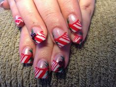 White acrylic nails with hand painted candycanes and holly with red Swarovski crystals.  Christmas