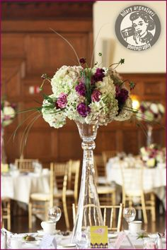 purple and white centerpiece with glass holder - great so you can see the guests across the table