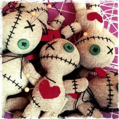"""Get revenge the old fashioned way! These adorable little 5"""" voodoo dolls can be carried in your bag, or attached to it.  I wanted to make voodoo dolls for quite some time. While trying to dye some socks, the fabric content made them come out an unsolid color. It was more like red heel socks, but not quite. When I flipped them inside out I was inspired to use them to make the voodoo dolls!  Makes a great key chain, too!  Includes 3 pins for your punishing pleasure.  Hand crafted from socks…"""