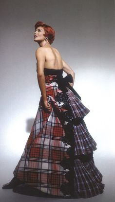 Linda Evangelista in Christian Lacroix's tartan ball gown in Dress Stewart tartan, with a pleated, fan-shaped cascade down the back, black velvet embroidery, and bow.