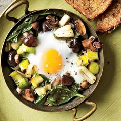 Eggs Baked Over Sautéed Mushrooms and Spinach - http://www.foodandwine.com/recipes/eggs-baked-over-sauteed-mushrooms-and-spinach
