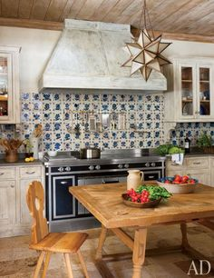 The kitchen's table and chair are from Switzerland's Engadine Valley, while the backsplash tiles are 17th-century Portuguese   archdigest.com