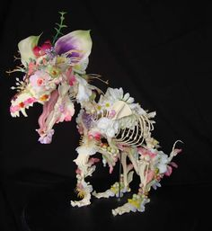 <b>If you really can't let your dog or cat go--and you have some psychological issues--then contact Dutch sculptor, Cedric Laquieze.</b> He takes animal skeletons and covers them in fake flowers, which is much classier than just keeping your lost pet in an urn on the mantle.