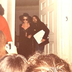 Leaving Apple  August 1969 - Fan snapshot of Pattie & George leaving the Apple office building at 3 Savile Row sorrounded by fans. Copyright by Patti Murawski.  Source of this scan is the Something About Pattie Boyd group at Yahoo! Photo sold thru...
