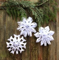 Make giant lighted snowflake pendants from paper bags or white paper. Easy tutorial with free templates. Beautiful decor for holidays and year round!