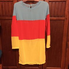 Woman's chiffon casual dress Baby blue, yellow, and orange stripes. Says size medium but defiantly fits like a small. Colors go great together. Never worn, brand new. I ordered it on line and it didn't fit Dresses Midi