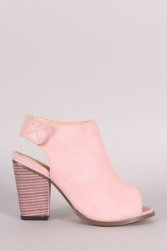 Description These booties feature a peep toe silhouette, vertical seam from top of the vamp to toe, back cutout detail, and chunky stacked heel. Finished with cushioned insole and slingback strap with