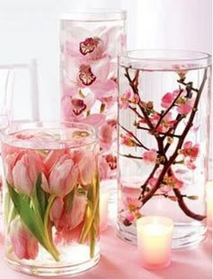 Distilled water, spring silk flowers, or real spring flowers if they're in bloom - ferns, violets or dandlions even.  Dollar Store vases. Float a candle on top.