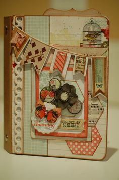 Button Farm  mini album. Don't you love the use of the playing card in that pennant?