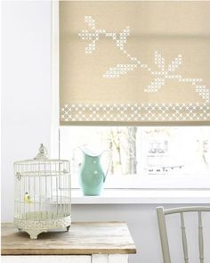 Instead of ordering new curtains or blinds, take a second look at the vinyl roller shades already hanging in your window. For just a little bit of money, you can embellish those budget basics into something that looks a little more custom and expensive.