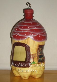 Ok..this site is spanish. But this is an extremely talented blogger. This is a picture of a bird house...made out of a 2L bottle. Just. Wow.