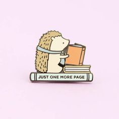 My popular Henrietta the Hedgehog pin is here in mini form and she just CANT put the book down! If youre a book lover and cant ever stop at just one more page, this is the pin for you! A little bit about Henrietta: she loves to read, knit (yes, she made her own scarf), quiet evenings