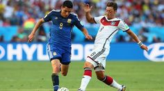 Enzo Perez of Argentina is challenged by Mesut Oezil of Germany Sunday, 13 July 2014 RIO DE JANEIRO, BRAZIL - JULY 13: Enzo Perez of Argentina is challenged by Mesut Oezil of Germany during the 2014 FIFA World Cup Brazil Final match between Germany and Argentina at Maracana on July 13, 2014 in Rio de Janeiro, Brazil. (Photo by Martin Rose/Getty Images) | www.dribblingman.com