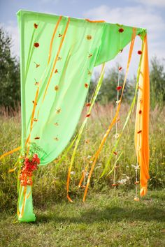 Green and orange wedding arch with gerberas