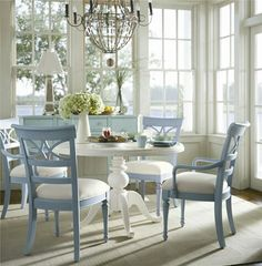 I like the idea of the cushions matching the table, and the chairs contrasting :)