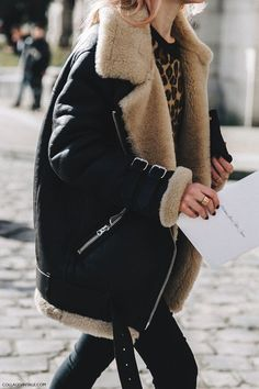 An oversized shearling coat is paired with skinny jeans and a leopard sweater