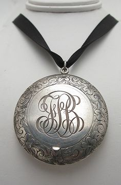 Engraved silver locket.