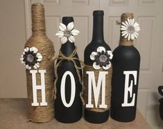 I custom make these wine bottles to any color or design you want. Sets include 4 bottles, each additional bottle is 7 dollars. Many colors to choose from some combinations are listed at lovetammyscraf (Bottle Painting Designs) Wine Bottle Gift, Glass Bottle Crafts, Diy Bottle, Bottle Art, Vodka Bottle, Diy Projects With Wine Bottles, Bottle Lamps, Beer Bottle, Custom Wine Bottles