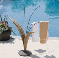Pool stuff on pinterest pool floats for adults foam for Outdoor towel caddy