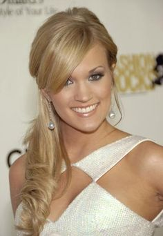 Carrie looks stunning with her curly ponytail and those amazing bangs!!