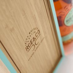 Crafted from bamboo, this hand-finished box boasts a strikingly raw and simple exterior, offset cleverly by the bold green border and etched Roe & Co logo. The front panel slides out smoothly to reveal the Roe & Co bottle, and has been cleverly designed to double as a cocktail preparation board. The natural antiseptic properties of the bamboo make it ideal for food preparation – whether you're slicing limes or piercing that perfect green olive. Limes, Food Preparation, Bamboo Cutting Board, Olive Green, Piercing, Cocktails, Exterior, Logo, Bottle