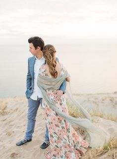 After surprising his bride-to-be with a sweet proposal at a lovely winery, Chris arranged this photo shoot for himself and Elise the very next day to celebrate the occasion. SARAH ELIZABETH DUNN spent the day with the couple on the beautiful … Continue Sarah Elizabeth, Lake Michigan, Engagement Shoots, Cover Up, Outfit Ideas, Photoshoot, Bride, Couple Photos, Couples