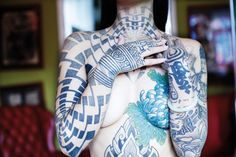 Right sleeve and neck are the work of tattoo artist Tomas Tomas. Photography by Thibault de Saint Chamas.