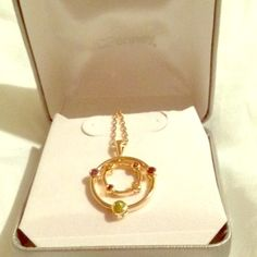 NWT JCPenny Gold Over Silver Necklace Gold over Silver SV Necklace from JCPenny. Never worn, never taken out of box. Still has tags attached. here's what is stated on tag: 14K over silver multi STN PND Garnet, Citrine, Peridot. AMETHYST ONE KISS. 18 in + 2 in extender. Made in China.NO TRADES NO ️️ Offers are welcome!  jcpenney Jewelry Necklaces