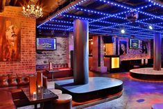 Jelsonimo - Russian karaoke bar and lounge boasts exposed brick walls, an LED ceiling and red/mahogany hues.