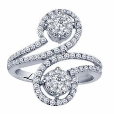 This beautiful bypass style diamond ring will add a swirl of sparkle to her finger.