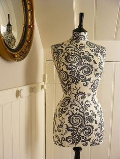 {Damask is my favorite print. This mannequin may overload my already-damasked bedroom, but I couldn't help but admire it's beauty. Photo By CorsetLacedMannequin/Courtesy Etsy}