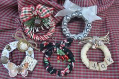 Mini Wreaths that can be used as ornaments,embellishments or gifts.  The base of the wreaths are made using a simple 3 or 4 inch curtain ring or shower curtain rings. 5 different ways to show you that this project can be adjusted for whatever holiday look you prefer.