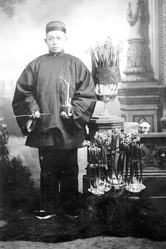 """Miner Toi Kee displays narcissus grown for the Chinese New Year celebration in Jacksonville, Oregon in the 1850s. Photograph by Peter Britt, courtesy of Southern Oregon Historical Society"" Possible Petruchio inspiration as a Chinese miner. This particular ensemble of clothing looks more dignified than other photograpsh of Chinese miners I've seen"