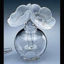 Lalique - vases, perfume bottles, candle stick holders - absolutely love them! Lalique Perfume Bottle, Antique Perfume Bottles, Vintage Perfume Bottles, Pink Perfume, Art Nouveau, Art Deco, Perfumes Vintage, Parfum Chanel, Beautiful Perfume