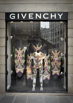 """Givenchy """"Birds of Paradise"""" Photo by Stefano Carloni with snowboards in back of mannequin Retail Windows, Store Windows, Givenchy, Shop Window Displays, Store Displays, Visual Merchandising Displays, Retail Boutique, Retail Shop, Shop Till You Drop"""