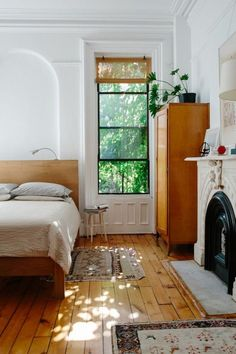 I love this room . . . light  and airy, cozy bed, door to garden, fireplace for ambience . . . .